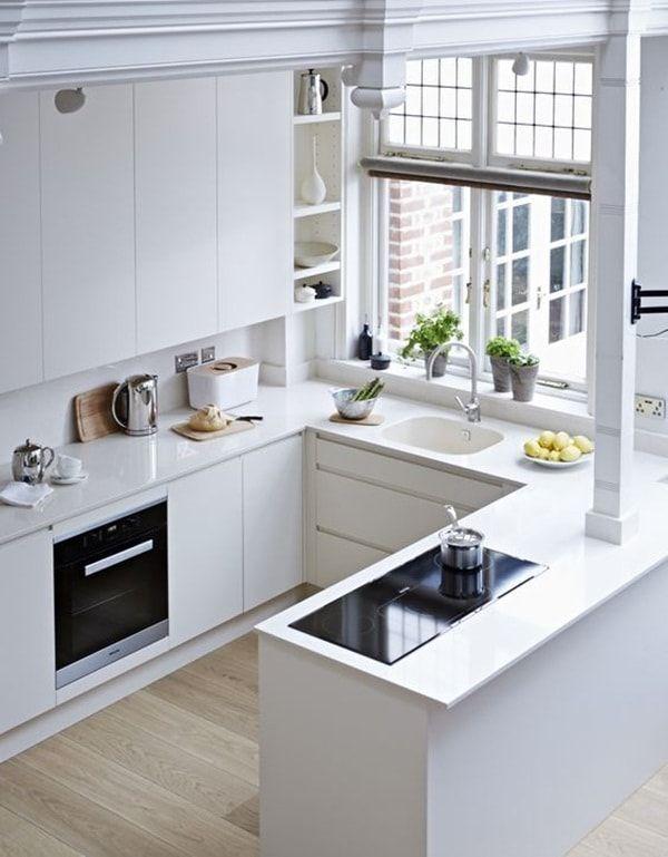 Cocina con peninsula de piedra blanca